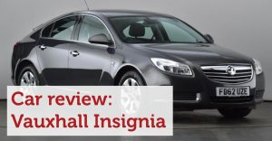 A black Vauxhall Insignia with red text saying Car Review: Vauxhall Insignia