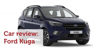 A blue Ford Kuga with text in front which says Car Review: Ford Kuga
