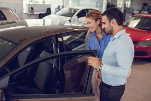 A man and woman view a car they can buy with a Red Potato Bad Credit Finance Agreement