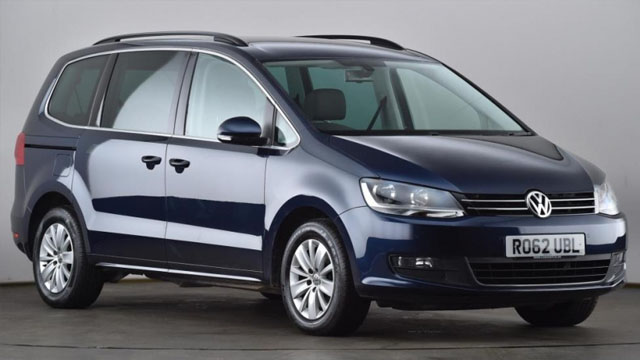 A blue Volkswagen people carrier